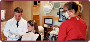 Superior dentist with adult patient