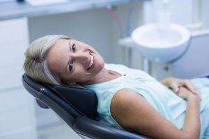 Smiling, comfortable woman in the dental chair.