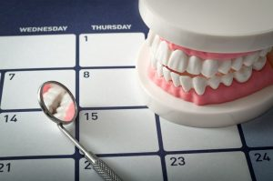 dental mirror laying on a calendar