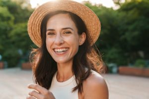 Woman smiling outside while avoiding ice cream