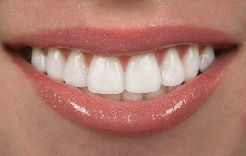 Person's smile after receiving teeth whitening